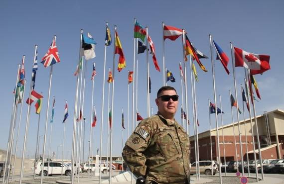 U.S. Army Maj. Mark Donahue poses for a photo in front of the flag plaza outside International Security Assistance Force Joint Command headquarters at North Kabul International Airport in Kabul, Afghanistan, April 6, 2013. Donahue was assigned as the Army National Guard's lead joint force manager. (U.S. Army courtesy photo)