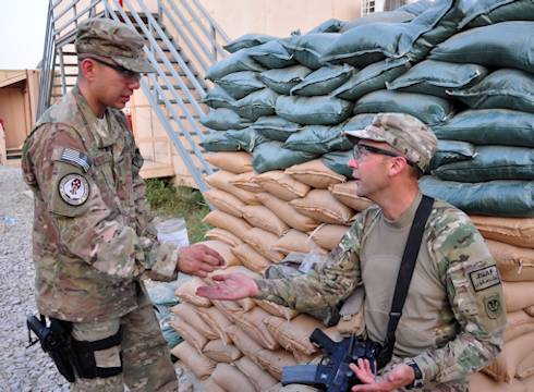 Senior Airmen Anthony Montejo, a combat medic attached to the 10th Sustainment Brigade, gives Sgt. 1st Class Jason R. Mattke, a convoy commander, 1157th Transportation Company, some Flexeril Aug. 24, 2012 at Jalalabad Airfield. Photo by Army Sgt. Gregory Williams