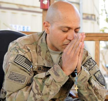 October 8, 2012 - U.S. Navy Petty Officer 2nd Class Victor Vazquez, Combined Joint Task Force 1, Intelligence Operations Specialist praying while deployed in Afghanistan.