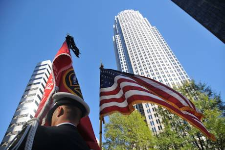 A Charlotte Fire Department Honor Guard stands at attention in front of the Bank of America Tower during the annual Carolinas Freedom Foundation Veterans Day Wreath Laying Ceremony in uptown Charlotte. NCNG photo by Tech. Sgt. Brian E. Christiansen