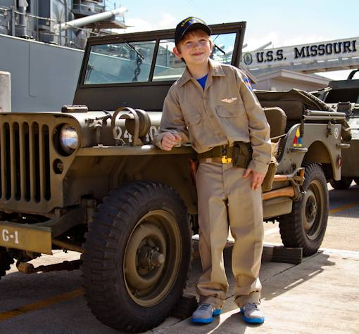 Carl Hornbeak-Hess, an 11-year-old from Mill Creek, Wash., who has been diagnosed with acute lymphoblastic leukemia, dreamed of becoming a World War II Army Air Corps pilot whose aircraft is shot down and crash lands on a deserted island. Hornbeak-Hess was granted his wish with the help of Marines, sailors and the Make-A-Wish Foundation. His journey began on February 15, 2013, when he flew into Honolulu International Airport and was picked up in an original World War II Jeep. In a convoy of WWII vehicles, he was brought to the USS Missouri Battleship Memorial. (Photo by USMC Lance Cpl. Nathan Knapke)