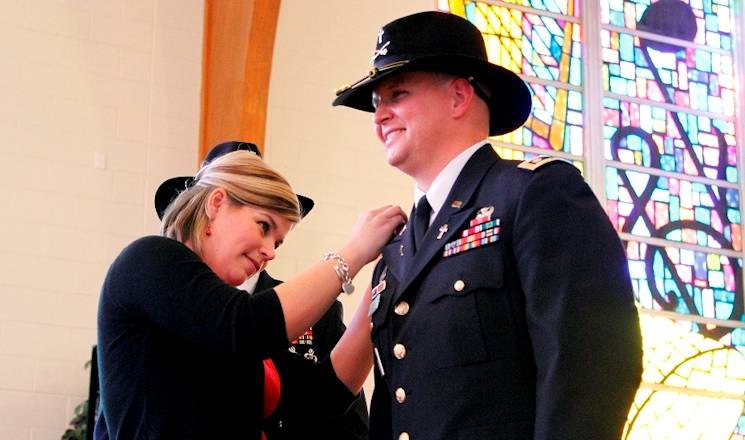 "Maj. Marshall Coen (right), a Killeen, Texas, native and chaplain for the 1st ""Ironhorse"" Brigade Combat Team, 1st Cavalry Division, gets pinned by his wife, Jill, also a Killeen native, at his promotion ceremony on Dec. 3, 2013 at Fort Hood, Texas. ""We're a team,"" Jill said. ""If I'm not going to be supportive, it's not going to work."" (U.S. Army photo by Pfc. Paige Pendleton, 1st BCT PAO, 1st Cav. Div.)"