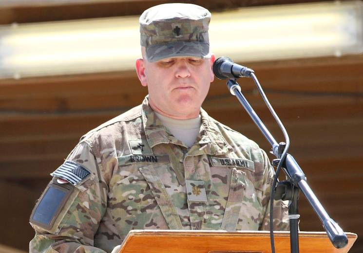 Maj. Rick Brown, chaplain with 4th Infantry Division, addresses a crowd of U. S. and NATO service members and civilians during a morning Regional Command (South) Memorial Day ceremony at Kandahar Airfield, Afghanistan, May 26, 2014. (U.S. Army photo by Sgt. 1st Class Brock Jones)
