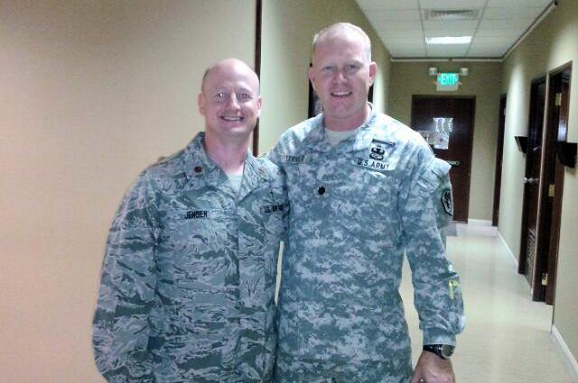 Air Force Maj. Wade Jensen reunites with Army Lt. Col. Brian Strider in Al Udied, Qatar, in August 2013 during their deployments. Jensen and Strider also served on the same four-man team during the 1st Gulf War in 1991. (Courtesy Photo)