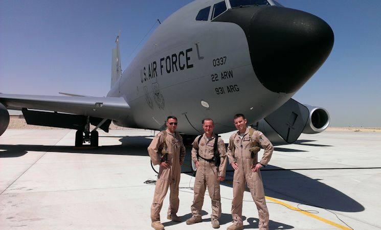 Maj. Robert Knapp, 22nd Air Refueling Wing executive officer, Capt. Brett McAuliff, 384th Air Refueling Squadron pilot, and Airman 1st Class Tim Neff, 350th ARS boom operator, stand in front of a KC-135 Stratotanker, July 25, 2013, at Manas, Kyrgyzstan. The Shell 72 crew won Air Mobility Command's 2013 General James H. Doolittle Trophy for providing aerial refueling in support of Operation Enduring Freedom. (Courtesy photo)