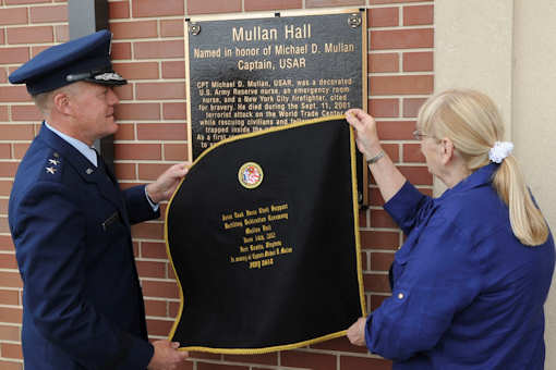 "U.S. Air Force Maj. Gen. Jonathan T. Treacy, Joint Task Force-Civil Support commander, and Theresa Mullan, ceremonially unveil the memorial plaque dedicating the JTF-CS headquarters as ""Mullen Hall,"" in a ceremony at Fort Eustis, Va., June 14, 2012. The building is named in honor of Theresa's son, the late U.S. Army Capt. Michael D. Mullan, a reservist, emergency-room nurse and decorated New York City firefighter who died while attempting to rescue fellow firefighters from the Marriott Hotel adjacent to the World Trade Center towers during the terrorist attacks of Sept. 11, 2001. Photo by USAF Senior Airman Wesley Farnsworth"