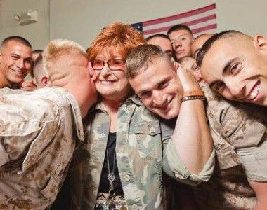 Laura Froehlich hugging troops
