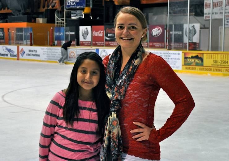 "Second Lt. Laura James, a 212th Fires Brigade communications officer, ice skates with Stephanie Garcia, 12, on November 4, 12 at the Ice Rink, El Paso, Texas. James is Garcia's ""big sister"" in the Big Brothers and Big Sisters program. James is one of 28 active military volunteers involved with the Military Mentorship Program the organization offers. (U.S. Army photo by Sgt. Summer Woode, 16th Mobile Public Affairs Detachment)"