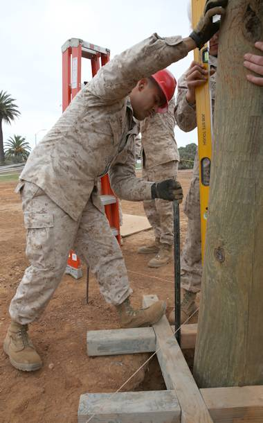 Sgt. Cesar Carreon, a combat engineer with Marine Wing Support Squadron 373 and a Houston native, adjusts a pole into a more level position while working at the obstacle course construction site aboard Marine Corps Air Station Miramar, Calif., Oct. 24, 2013. Combat engineers have a wide variety of skills; construction and site management are just two skills they constantly work to master. (U.S. Marine Corps Lance Cpl. Christopher Johns)