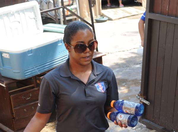 Sergeant Darlissa Leatherwood, the legal chief for the 8th Marine Corps District, carries Gatorade to people participating in a charity event. Leatherwood volunteers when ever she can because of the model set by her family. (U.S. Marine Corps photo by Cpl. Alfredo Ferrer, September 16, 2013)