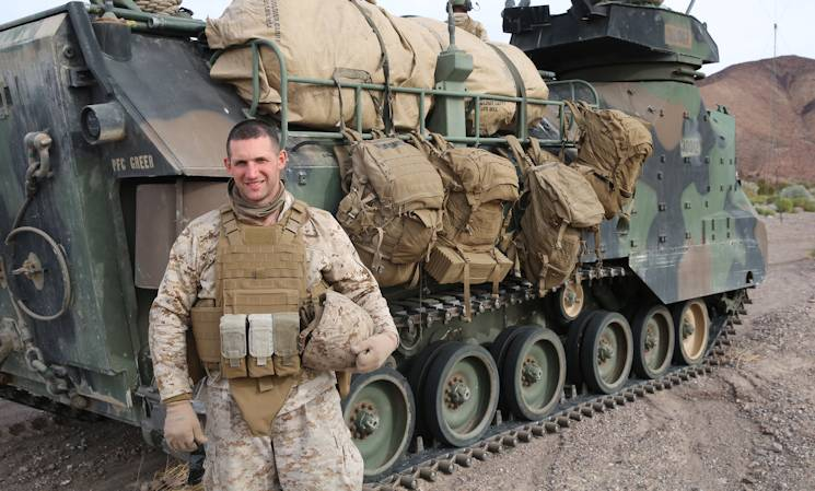 Captain Eric Mattoon, 29, from Hilton Head, S.C., the 2nd Battalion, 5th Marine Regiment, Headquarters and Support Company Commander stands in front of an amphibious assault vehicle during training exercise Steel Knight aboard Marine Corps Air Ground Combat Center Twentynine Palms, Calif., Dec. 14, 2014. (U.S. Marine Corps photo by Lance Cpl. John Baker)