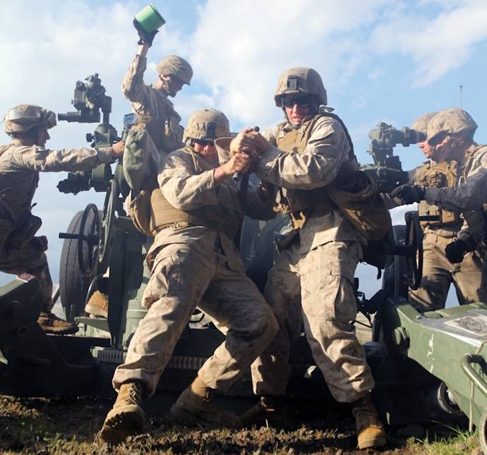 Lance Cpl. John R. Chiri, left, and Cpl. John J. Stubbs ram a 155 mm high-explosive round into the breech of an M777A2 155 mm lightweight howitzer at CATC Camp Fuji, Oct. 2, 2013 as part of Artillery Relocation Training Program 13-3. Ramming the round is a two-man job, according to Stubbs. It takes a lot of strength and, through teamwork, Stubbs and Chiri are able to load the howitzer quickly. Chiri and Stubbs are field artillery cannoneers with the unit. (U.S. Marine Corps photo by Lance Cpl. Henry J. Antenor)