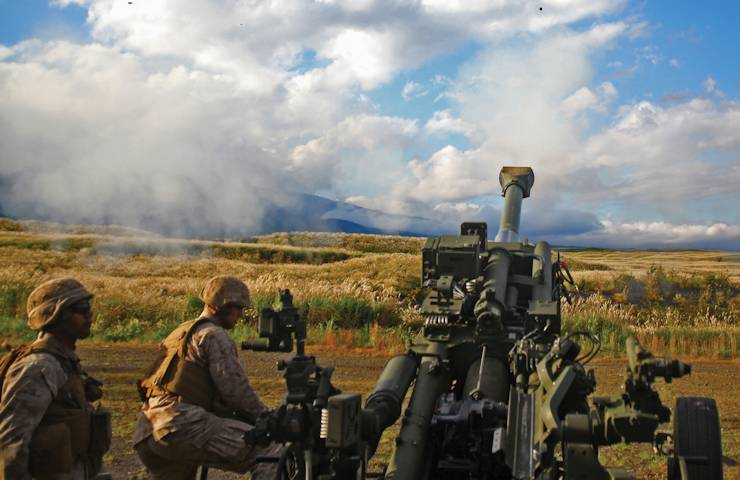 Marines with Battery F fire an M777A2 155 mm lightweight howitzer Oct. 2, 2013 at Combined Arms Training Center Camp Fuji as part of Artillery Relocation Traning Program 13-3. (U.S. Marine Corps photo by Lance Cpl. Henry J. Antenor)
