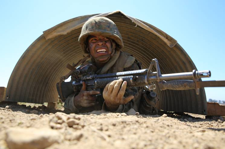 Private Alfonso A. Medina-Arellano, Platoon 3223, Kilo Company, 3rd Recruit Training Battalion, low crawls during the Bayonet Assault Course as part of the Crucible at Edson Range, Marine Corps Base Camp Pendleton, CA on Sept. 11, 2014. Over the past three months, recruits learned different bayonet techniques during Marine Corps Martial Arts Program training. (U.S. Marine Corps photo by Cpl. Jericho Crutcher)