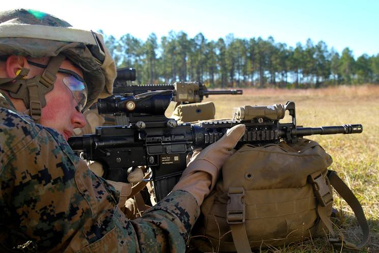 Lance Cpl. Sawyer W. Marchand, a radio operator with Bravo Company, Battalion Landing Team 3rd Battalion, 6th Marine Regiment, 24th Marine Expeditionary Unit, fires an M16-A4 service rifle during a weapons calibration shoot at Camp Lejeune, N.C., Nov. 7, 2014. The Marines conducted the training to ensure all weapon systems are working properly and are ready for the upcoming deployment at the end of the year. (U.S. Marine Corps photo by Lance Cpl. Austin A. Lewis)