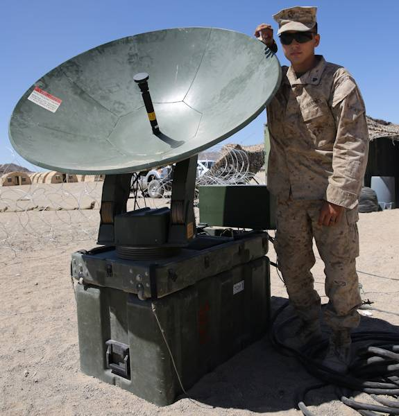 Corporal Steven Rice, data specialist, Headquarters and Service Company, 3rd Battalion, 7th Marine Regiment, ensures that the Marines of 3rd Battalion, 7th Marine Regiment stay connected using a Support Wide Area Network (SWAN) to gain communications for the battalion during an integrated training exercise here, Aug. 13, 2013. Rice, 22, a native of Littleton, Colo., is in charge with setting up, operating and maintaining the SWAN to ensure the Marines in the battalion can communicate with one another. The ITX is a month long training event the Marines go through prior to deployment. (Courtesy Photo)
