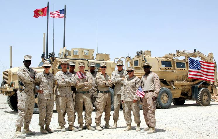 U.S. Marines with Redeployment and Retrograde in support of Reset and Reconstitution Operations Group pose for a photo on the Fourth of July aboard Camp Leatherneck, Helmand province, Afghanistan. U.S. service members throughout Regional Command (Southwest) gathered with their units to honor Independence Day while deployed to Afghanistan, July 4, 2014. (U.S. Marine Corps photo by 1st Lt. Garth Langley)