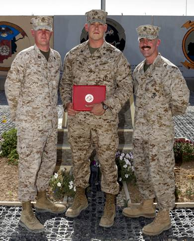 Staff Sgt. James K. Donnelly, a maintenance chief with 1st Maintenance Battalion (Forward) (left), 1st Marine Logistics Group, and Major Nathaniel A. Baker, a pilot with 3rd Marine Air Wing (Fwd) (right), congratulate their brother, Sgt. Thomas M. Baker, an embarkation specialist with I Marine Expeditionary Force (Fwd), after his promotion ceremony at Camp Leatherneck, Afghanistan, May 1, 2012. The three brothers, from Bowling Green, Ky., had the opportunity to meet up on Camp Leatherneck regularly when all three were deployed to Afghanistan at the same time. Courtesy Photo