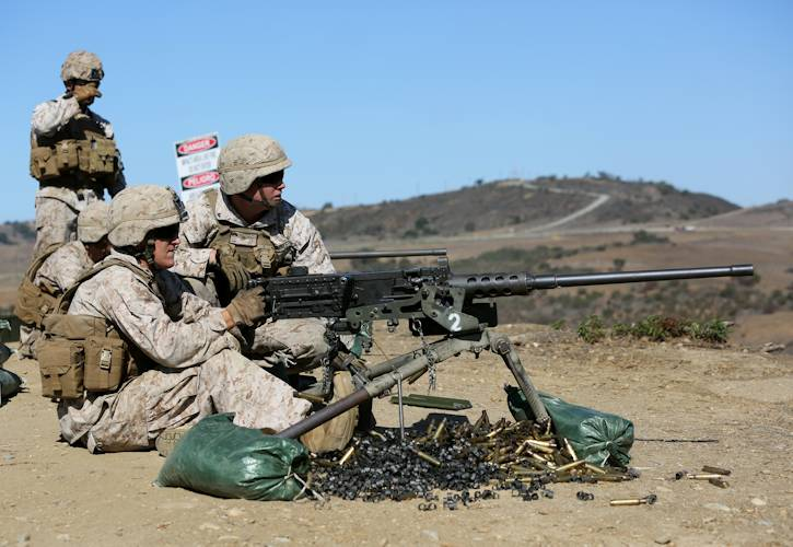 Lance Cpl. William Krueck (right), a machine gunner with Alpha Company, 1st Battalion, 1st Marine Regiment, and a native of Milwaukee, evaluates Lance Cpl. Pete Williams, a machine gunner with Alpha Co. and native of San Diego, as he engages targets with a .50 caliber machine gun during a live-fire exercise on Range 222, Sept. 4, 2013. (U.S. Marine Corps photo by Cpl. Joseph Scanlan)