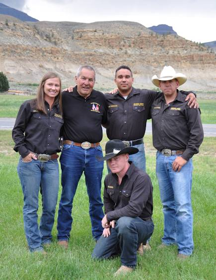 Former Marine Sgt. Gary Brown (second from left) poses with the Marine Corps Mounted Color Guard wearing his official MCG belt buckle on July 5, 2013 in Cody, Wyo. The MCG Marines are wearing buckles presented to them from the Cody Stampede Rodeo committee for their hard work and part in Cody's Fourth of July celebrations. (U.S. Marine Corps photo by Pfc. Samuel Ranney)