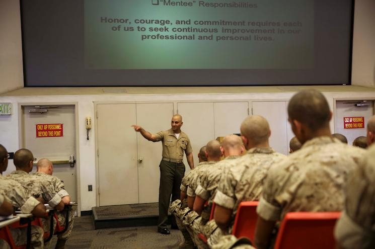 First Sergeant Cristopher Demosthenous, company first sergeant, Charlie Company, 1st Recruit Training Battalion, engages recruits during a mentorship class at Marine Corps Recruit Depot San Diego, Calif., Sept. 1, 2014. (U.S. Marine Corps photo by Sgt. Walter D. Marino II)