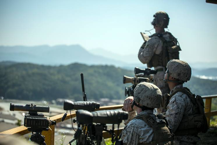 U.S. Marines watch the sky for aircraft Oct. 8, 2014 at Rodriguez Live Fire Complex during Korean Marine Exchange Program 14-13. KMEP 14-13 is one iteration in a series of continuous combined-training exercises designed to enhance the Republic of Korea and U.S. alliance, promote stability on the Korean Peninsula and strengthen ROK-U.S. military capabilities and interoperability. The U.S. Marines are with 5th Air Naval Gunfire Liaison Company, III Marine Expeditionary Force Headquarters Group, III MEF. (U.S. Marine Corps photo by Cpl. Stephen D. Himes)