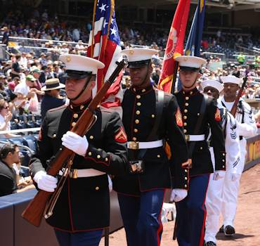 "A joint Navy-Marine Corps color guard marches with the colors during their appearance at a military appreciation ceremony at a San Diego Padres baseball game at Petco Park, May 25, 2014. ""It was a great time for camaraderie and reflection,"" said Navy Lt. Travis Jewell, chaplain, 3rd Battalion, 4th Marines, 7th Marine Regiment. (U.S. Marine Corps photo by Lance Cpl. Paul Martinez)"