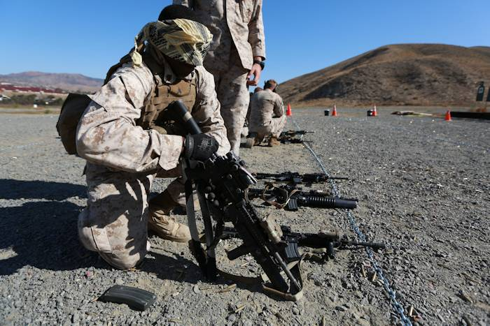 U.S. Marine Sgt. James Brooks conducts malfunction drills during a raid-leaders course aboard Camp Pendleton, Calif., Oct. 8, 2014. Brooks, 24, from Cincinnati, Ohio, is an anti-tank missileman with 3rd Battalion, 1st Marine Regiment. Marines with 3/1 are the Battalion Landing Team with the 15th Marine Expeditionary Unit. (U.S. Marine photo by Cpl. Steve H. Lopez)
