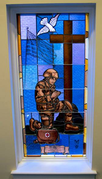A stained glass window was recently installed in memory of 2nd Lt. Matthew Blount at the First Baptist Church in Pelham, Ala. Blount was commissioned on March 7 and passed away on March 10 due to leukemia and cancer. According to all who knew him, the Praying Soldier design embodied the spirit of the young officer from his youth through his Army career as a combat medic as well as a member of his family, his church and community. The window was put in place on December 15, 2012 during a small ceremony at the church after which attendees could see the finished product. Photo by Army Sgt. 1st Class Joel Quebec