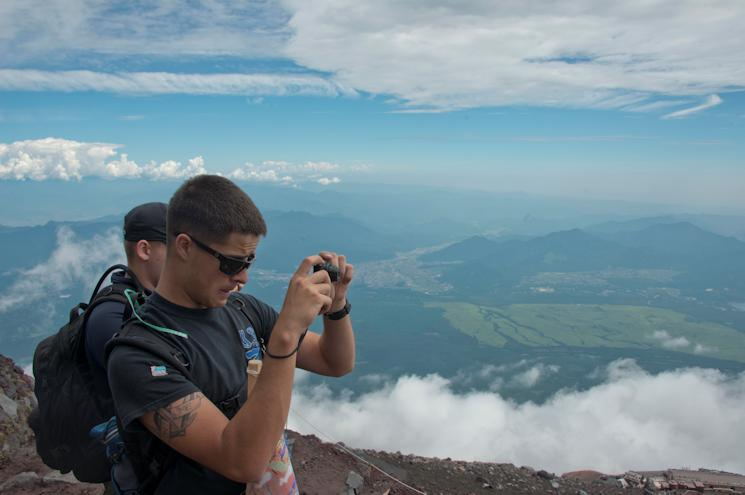 Airman Cole Voeller, of Naval Air Facility (NAF) Atsugi, stops to take a picture during the second bi-annual All-Japan Liberty climb up Mount Fuji on August 2, 2014. (U.S. Navy photo by Mass Communication Specialist 3rd Class Ryan G. Greene)