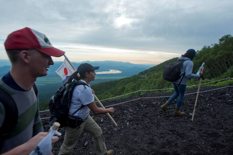 August 2, 2014 - Mass Communication Specialist 3rd Class Sarah Villegas and Mass Communication Specialist 3rd Class Jeremy Graham, both of Commander, Fleet Activities Sasabo, begin their climb up Mount Fuji as part of the bi-annual All-Japan Liberty climb. The initiative aims to build camaraderie and a sense of community for junior Sailors stationed in the 7th Fleet area of responsibility. (U.S. Navy photo by Mass Communication Specialist 3rd Class Ryan G. Greene)