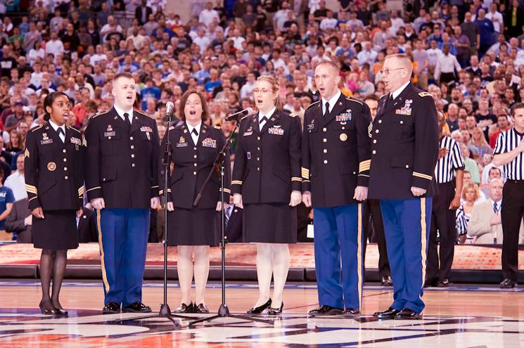 "Members of the Indiana National Guard sing the ""National Anthem"" at a 2014 NCAA Final Four basketball game in Indianapolis. There are a number of other ways Soldiers can reach out to the local community. (U.S. Army photo by John Crosby)"