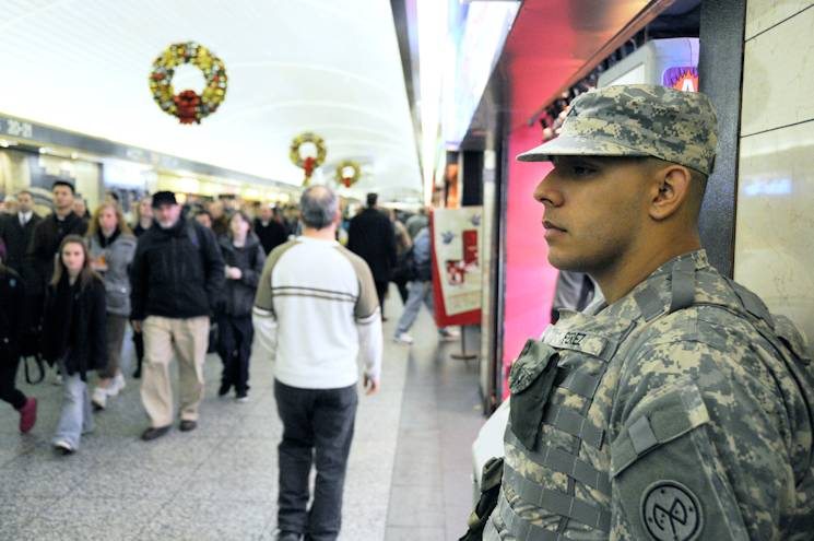 Pvt. Stephen Perez, a New York Army National Guard member assigned to Joint Task Foce Empire Shield, patrols at Penn Station in New York City, Nov. 23, 2010. (New York Air National Guard photo by Staff Sgt. Marcus P. Caliste)