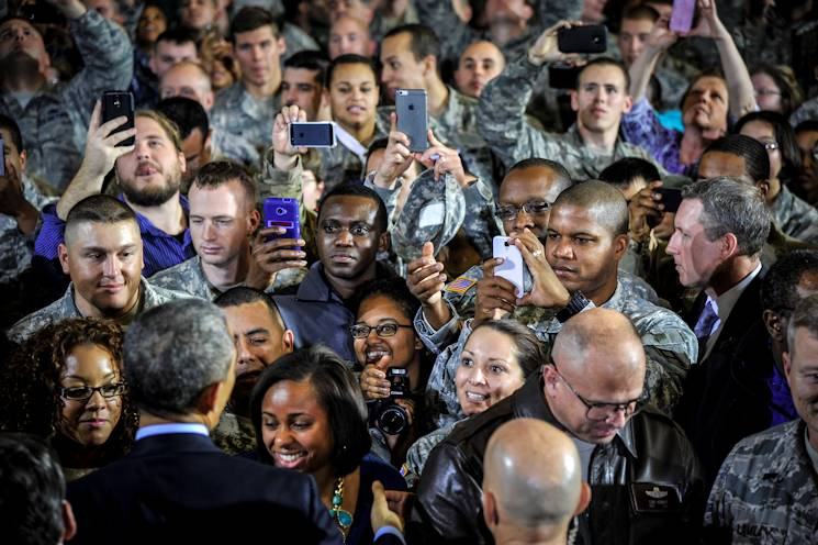 Service members and Department of Defense civilians shake hands and take photos of United States of America President Barack Obama after addressing a crowd of more than 3,000 people at Joint Base McGuire-Dix-Lakehurst, N.J., Dec. 15, 2014. The President visited the joint base to express his gratitude to service members and DOD civilians for serving their country. (U.S. Air Force photo by Staff Sgt. Scott Saldukas)