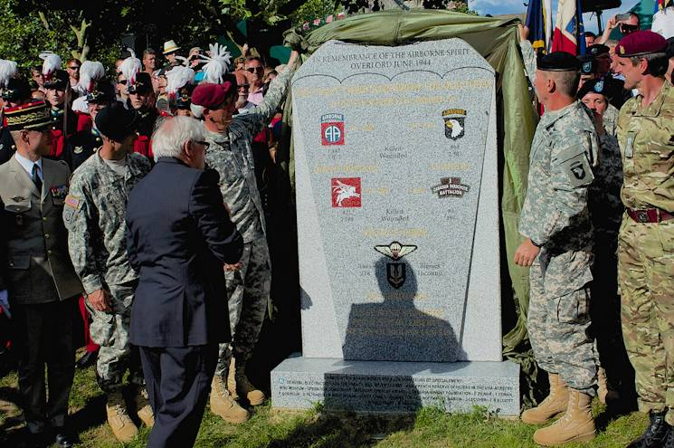 Maj. Gen. James C. McConville, right, and Maj. Gen. John W. Nicholson, left, unveil a new paratrooper memorial June 8, 2014, in Sainte-M�re-�glise, France. McConville is the commanding general of the 101st Airborne Division (Air Assault), while Nicholson commands the 82nd Airborne division. Both leaders attended the ceremonies surrounding the 70th anniversary of their units landing in France, on D-Day 1944. (Photo by USAF Senior Airman Alexander W. Riedel)