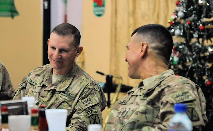 "U.S. Army Lt. Col. Kenneth Harrison and Command Sgt. Maj. Noe Salinas share a light moment during the first Forward Operating Base Gamberi prayer breakfast Dec. 6, 2013. Salinas serves as the senior enlisted adviser of 4th Brigade Combat Team, 10th Mountain Division, Task Force Patriot and Harrison serves as the commander of 4th Brigade Special Troops Battalion, 4th BCT, 10th Mtn. Div. The topic of the prayer breakfast was the ""Character of a Leader."" (U.S. Army Photo by Sgt. 1st Class E. L. Craig, Task Force Patriot PAO)"
