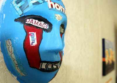 A mask, painted by a Marine who attends art therapy to relieve post-traumatic stress disorder symptoms, is displayed at an art expo May 3, 2012. The expo provided a way to raise awareness about PTSD and the benefits of art therapy. During therapy sessions, participants use a variety of art supplies, including paints, clay, markers, charcoal and images for collages, to express their thoughts, feelings and memories. Official U.S. Marine Corps photo by Cpl. Andrew Johnston