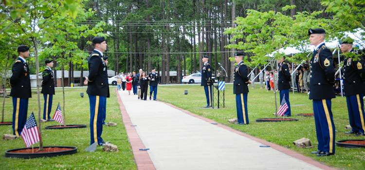 Family members of the fallen soldiers are escorted down Warrior's Walk at the beginning of the tree dedication ceremony at Fort Stewart, GA on April 18, 2013. Eight soldiers from the 3rd Infantry Division were honored with trees after making the ultimate sacrifice in Afghanistan last month. (U.S. Army photo by Sgt. Emily Knitter)