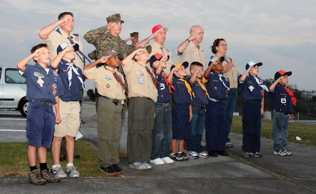Boy Scouts, Cub Scouts, parents and volunteers salute the flag during a recent evening colors ceremony at building 1 on Camp Foster on November 6, 2012. The boys attended the ceremony to learn the history of the American flag and the significance of evening colors. The class is a part of the Boy Scouts' progression from Wolf Cubs to Bear Cubs. Photo by Lance Cpl. Adam B. Miller
