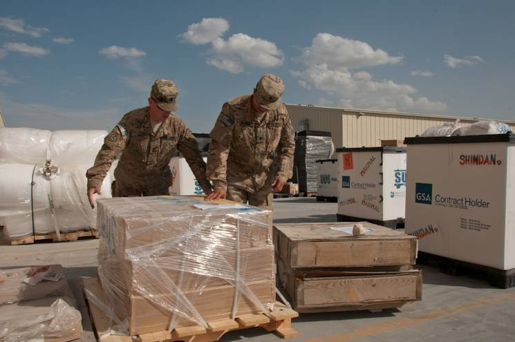 Sgt. 1st Class Jeffrey Niles, logistics liaison noncommissioned officer in charge, and Spc. Jaime Rivera, Shindand liaison, both assigned to the 419th Combat Sustainment Support Battalion, unpack equipment at the Bagram supply support activity August 28, 2014. Soldiers at the SSA support Soldiers and civilians in the area of operations by ensuring they are properly supplied and equipped to maintain unit strength enabling strategic and operational reach. (U.S. Army photo by Sgt. 1st Class Luis Saavedra, 10th Sustainment Brigade PAO)