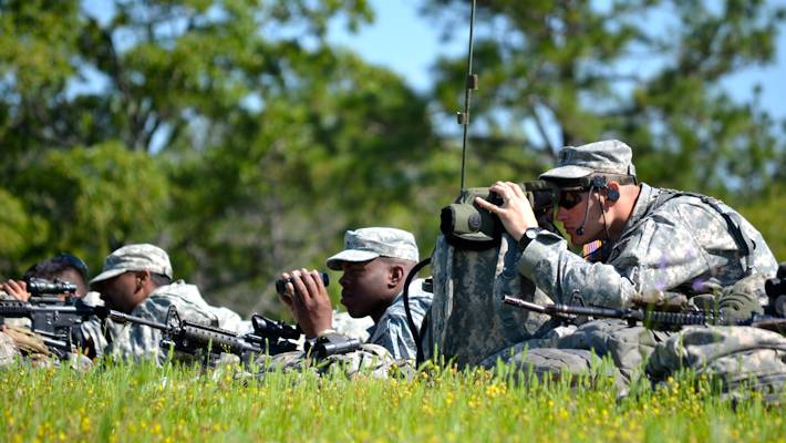 U.S. Soldiers with the 4th Brigade Combat Team, 10th Mountain Division, keep their eyes on the objective from an observation post during Advanced Situational Awareness Training at Fort Polk, La., May 4, 2013. Soldiers of 10th Mountain Division used a wide variety of optics to detect insurgent activity in a mock village. (U.S. Army photo by Staff Sgt. Kulani J. Lakanaria)