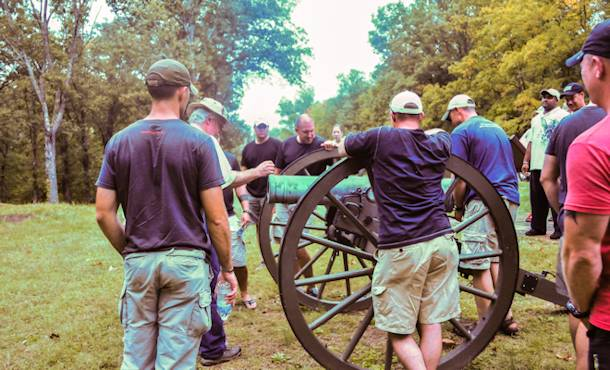 Officers and senior enlisted with 1st Battalion, 502nd Infantry Regiment, 2nd Brigade Combat Team, 101st Airborne Division (Air Assault), gather around a cannon used during the civil war by the confederates defending Fort Donelson, Sept. 28, 2012. The cannons were used with other defense techniques to keep the encroaching Union soldiers at bay. Photo by Army Sgt. Charlene Moler