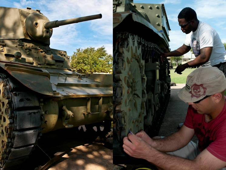 "Spc. David Vass (bottom) and Spc. Telvin Mathews (top), both with 6th Squadron, 9th Cavalry Regiment, 3rd Brigade Combat Team, 1st Cavalry Division, place tape around parts of the M-3 Light Tank ""Stuart"" prior to painting Sept 24, 2014 at Fort Hood, Texas. Vass, a Tampa, Fla., native and Mathews, a Birmingham, Ala., native, prepped and painted the tank in order to restore it as part of the Adopt-a-Vehicle program at the 1st Cavalry Division Museum. (U.S. Army photo by Sgt. Brandon Banzhaf, 3rd BCT PAO, 1st Cav. Div.)"