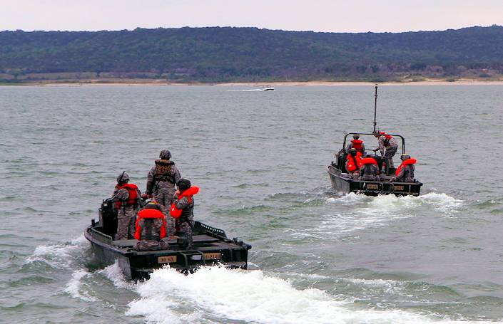 U.S. Soldiers with Delta Company, 4th Attack Reconnaissance Battalion, 227th Aviation Regiment, 1st Air Cavalry Brigade, 1st Cavalry Division, depart via boat to begin their water egress training during Operation Gun Rescue at Belton Lake in Fort Hood, Texas, May 8, 2013. (U.S. Army photo by Sgt. Christopher Calvert)
