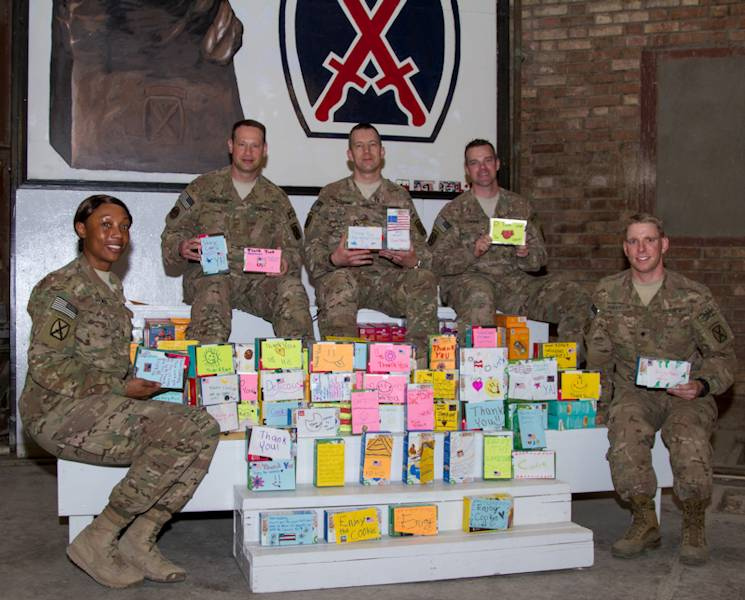 U.S. Army Maj. Matthew Starsnic (center) poses with fellow 10th Mountain Division (Light Infantry) Soldiers: Chief Warrant Officer 3 Andrea Ebanks-Joyner, Chief Warrant Officer 2 Ron Johnson, Capt. Matthew Gowens, and Spc. Blake Anderson, surrounded with Girl Scout cookies, at Bagram Air Field, April 18, 2014. Girl Scout Troop #50469, of Moon Township, Pa., donated 240 boxes of cookies to 10th Mountain Division deployed troops through their Operation Sweet Appreciation. (U.S. Army photo by Master Sgt. Kap Kim)