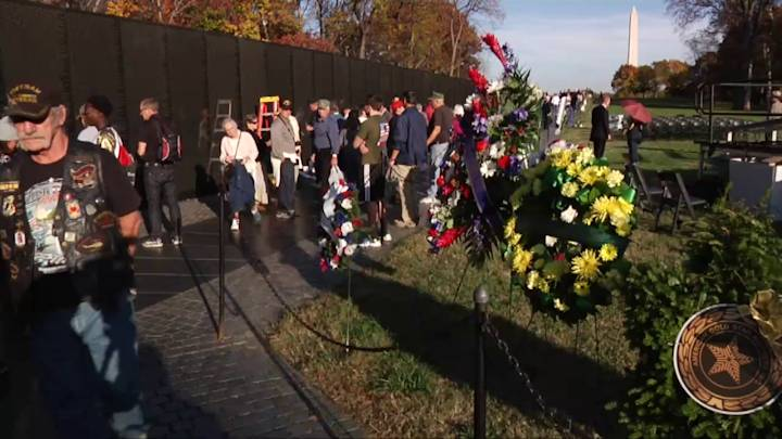 Visitors at the Vietnam War Memorial on the National Mall November 11, 2014