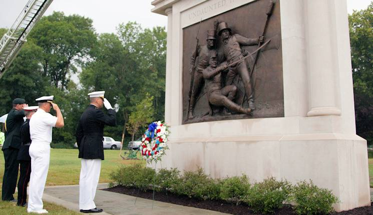"The ""Undaunted in Battle"" memorial to the Battle of Bladensburg, designed and sculpted by Joanna Blake, was dedicated at Bladensburg, Maryland, Aug. 23, 2014. The monument features a bronze sculpture of the end of the battle. It depicts a wounded Commodore Joshua Barney, commander of the Chesapeake Flotilla, Charles Ball, a freed slave and flotilla man, and an unnamed Marine, in honor of the Marines who fought to the bitter end trying to repel British forces. (U.S. Marine Corps photo by Sgt. Justin Boling)"