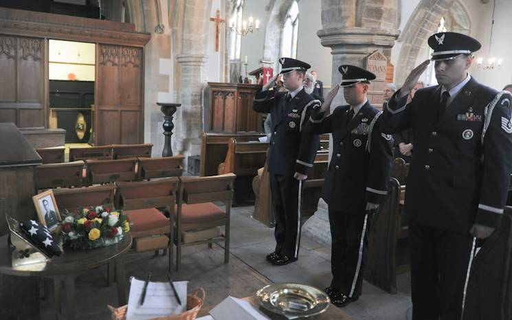 The 422nd Air Base Group Honor Guard salutes the memorial for 10 Airmen killed when their B-17 bomber crashed in at the Astwell Castle Farms in 1943 during a memorial service in the Parish Church of St. Mary Magdalene in Helmdon on November 2, 2013. The ceremony honored the 327th Bombardment Squadron, VIII Bomber Command, Airmen killed November 30, 1943, when they left RAF Poddington on a bombing mission to Germany. (U.S. Air Force photo by Staff Sgt. Brian Stives)