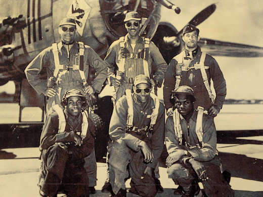 Former 1st Lt. Edward Gibson, an original Tuskegee airman, is seen in this photo (back row, right) in front of a B-25 bomber with his crew during World War II in the mid-1940s. Gibson served in the Army Air Corps as a bombardier-navigator and logged 2,300 flight hours. (Courtesy photo)