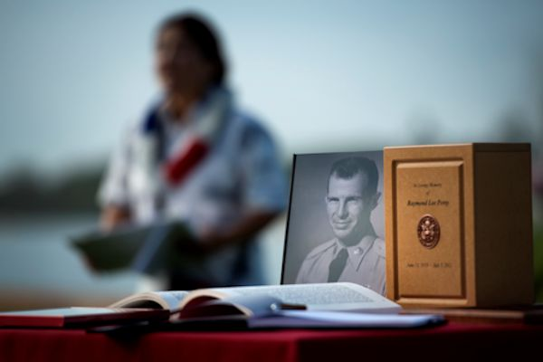 Retired Senior Master Sgt. Raymond Perry's photo is displayed during the 71st anniversary remembrance ceremony on Joint Base Pearl Harbor-Hickam, Dec. 7, 2012. Perry, a survivor of the attacks, went on to serve 26-years in the Air Force and was a founding member of the pararescue career field. U.S. Air Force photo by Staff Sgt. Mike Meares